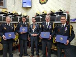 Hierdense brandweermannen koninklijk onderscheiden